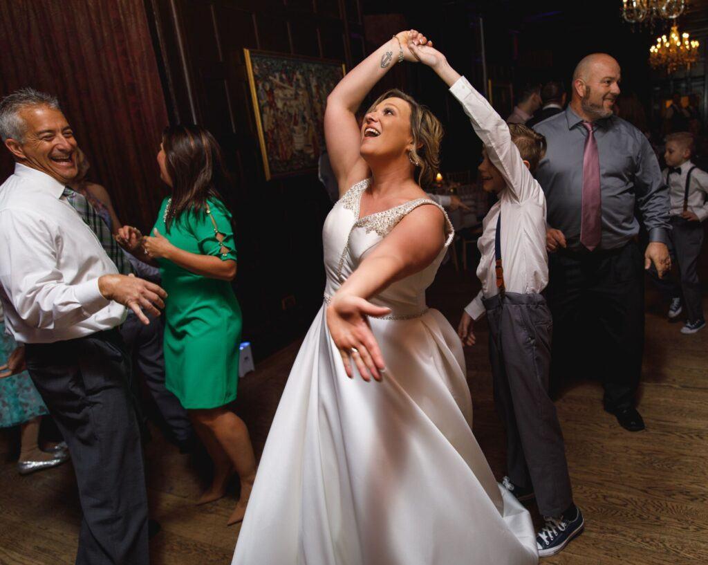 A happy bride dancing at Bartley Lodge Hotel;
