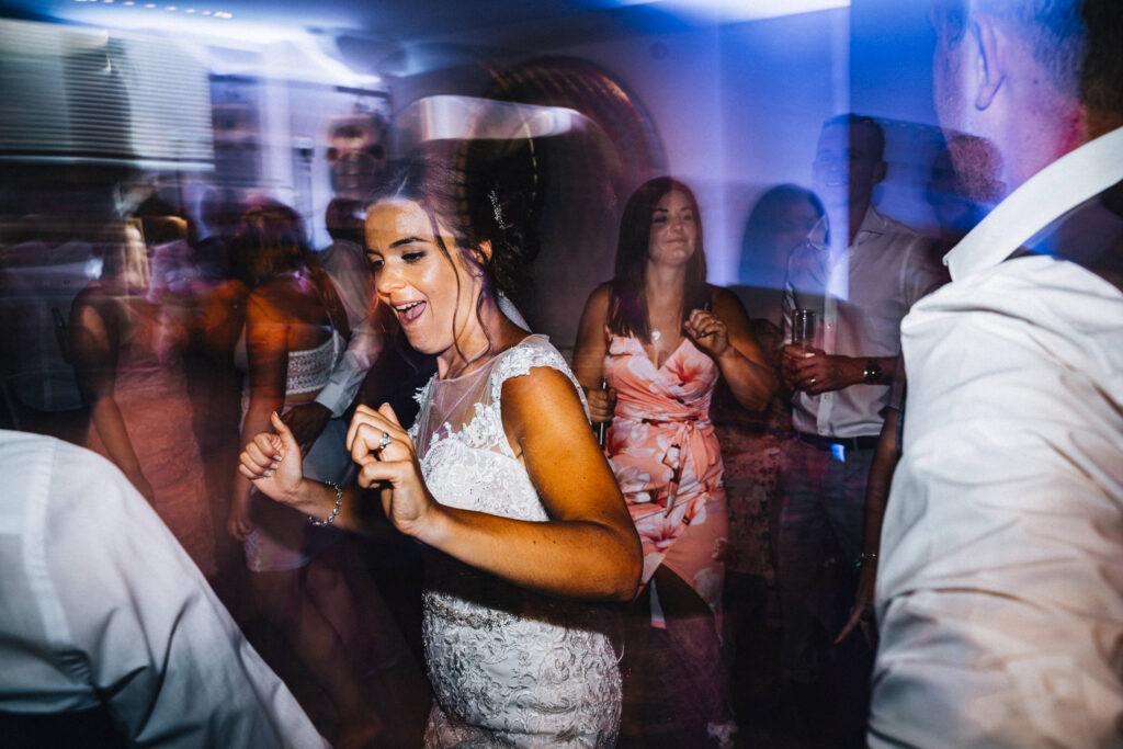 Another happy bride dancing with the wedding DJs at Wickham Vineyard