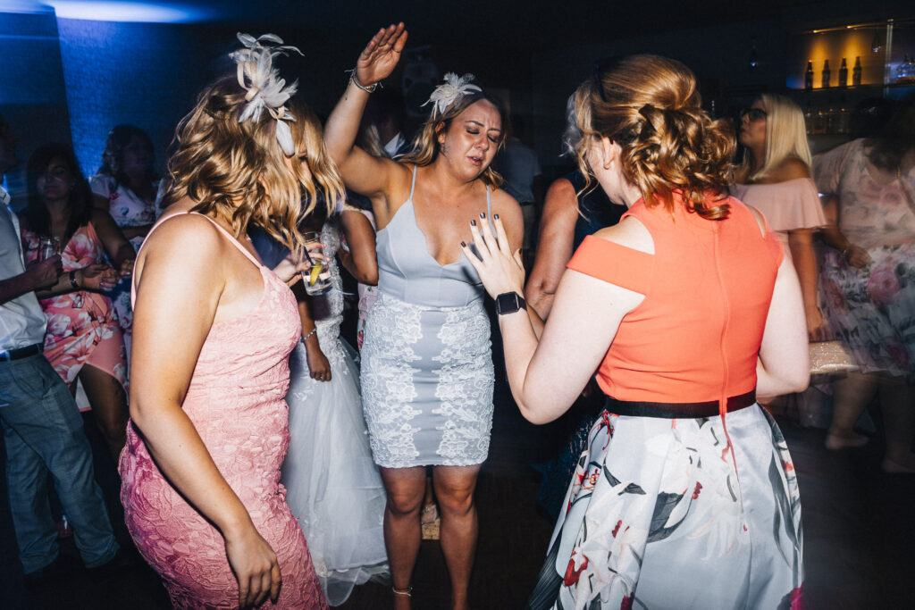 Guests dancing with the wedding DJs at Wickham Vineyard