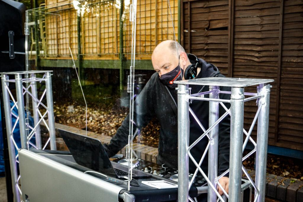 A covid safe dj performing at a wedding